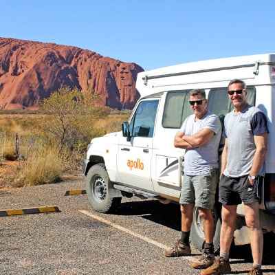 two people at Uluru with Apollo Camper