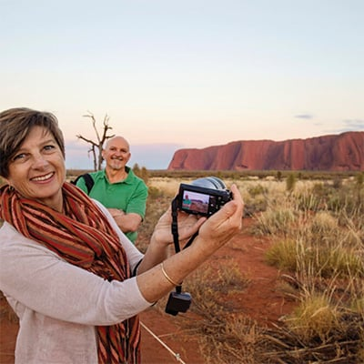 Couple taking a photo in front of Uluru